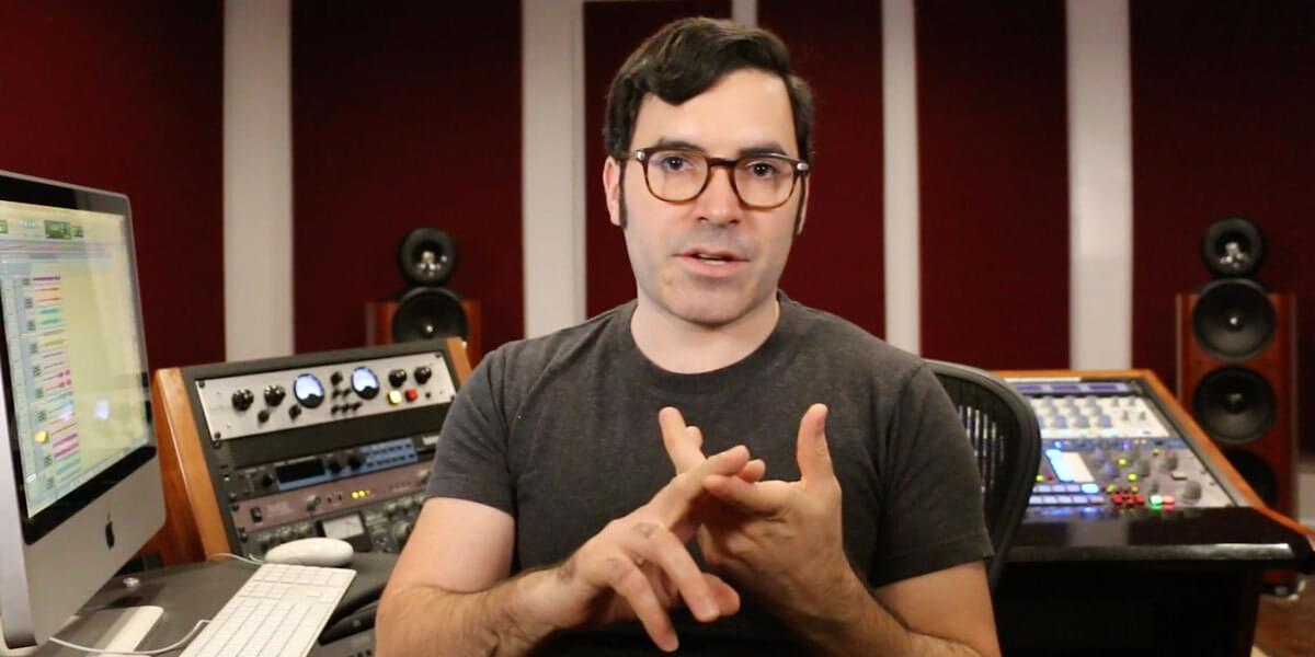 Justin Colletti in the mastering studio teaching
